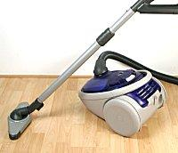 A vacuum sitting on a wooden floor