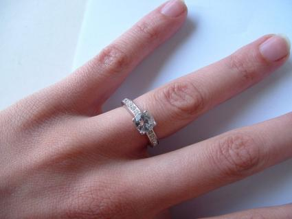 Palladium engagement ring on woman's finger