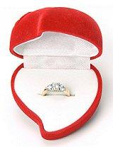 Red heart-shaped engagement ring box