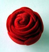 Image of a red rose-shaped ring box