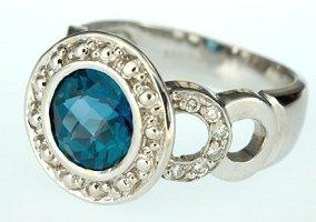 Blue diamond, bevel-set engagement ring