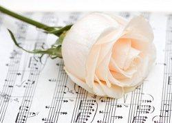 Rose on sheet music