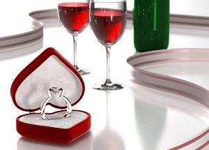 Wine and engagement ring in heart-shaped box