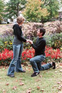 Couple getting engaged in a garden