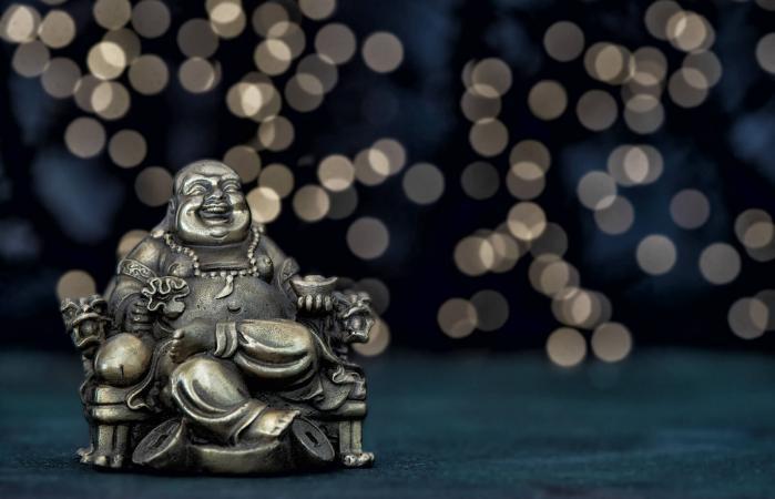 Buda sentado Dinero de la riqueza