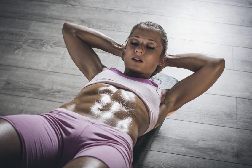 https://cf.ltkcdn.net/exercise/images/slide/247375-850x567-woman-doing-crunches.jpg