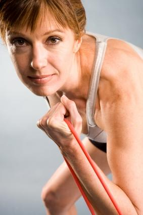 Woman exercising with resistance bands.
