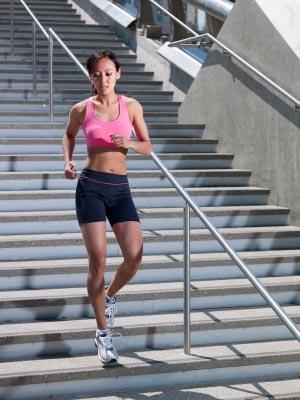 Woman running down stairs