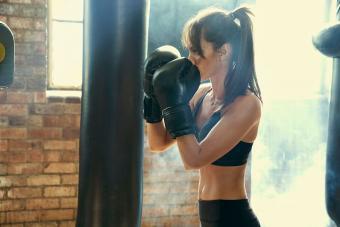 Woman hitting heavy punching bag