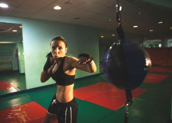 woman punching reflex bag