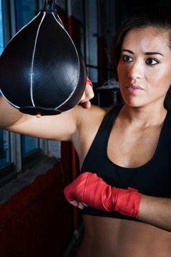 Female boxer using speed bag