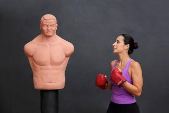Woman ready to punch dummy bag