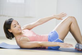 Woman exercising on yoga mat
