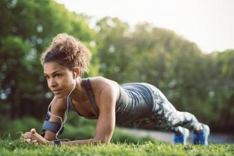 Sporty woman doing plank exercise at park