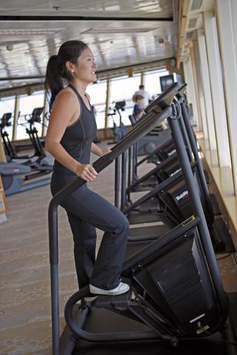Woman on stair stepper machine