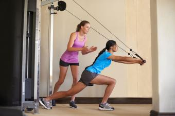 Women using cable and pulley machine