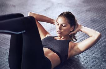 Woman working core at gym