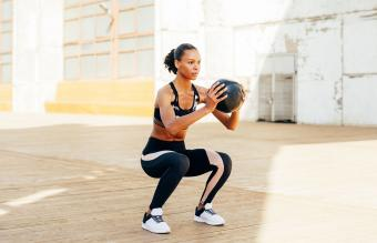 Woman With Medicine Ball Exercising