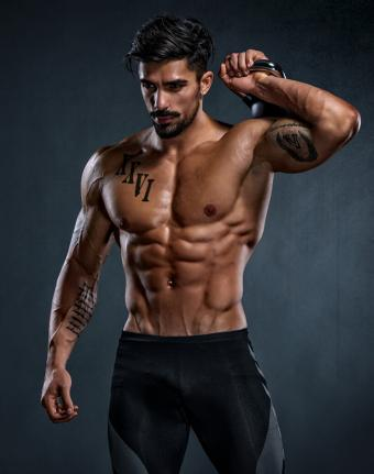 https://cf.ltkcdn.net/exercise/images/slide/246313-671x850-man-with-muscular-abs.jpg