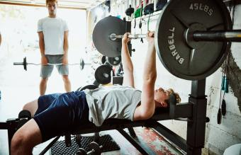 Man working out at home gym