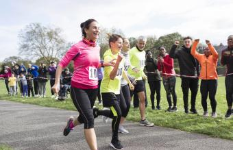 Runners running in charity run at park