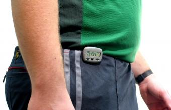 Man waist with a pedometer on pants