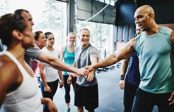 Group celebrating together in gym