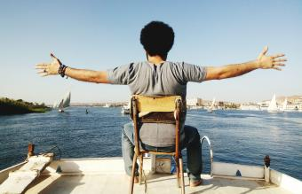 Man Sitting On Chair In Boat