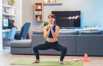 Woman performing sumo squat