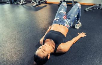 Young woman doing core exercises at the gym