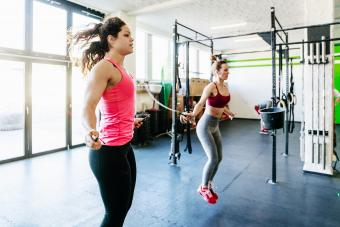 two women jumping rope in gym