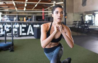 Female athlete exercising at boxing gym
