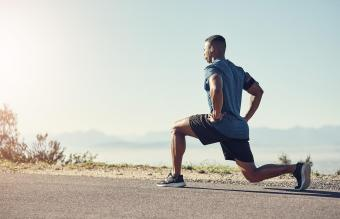 man doing lunges outdoors
