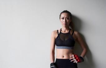 Portrait of confident female boxer