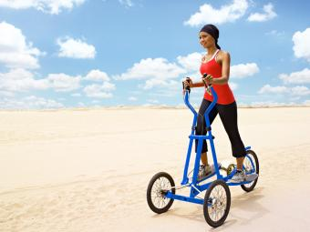 Woman on a StreetStrider Outdoor Elliptical