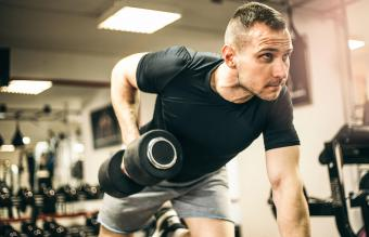 Man Exercising with Arm Weights