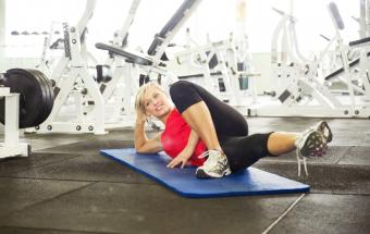 Woman stretching in gymnasium