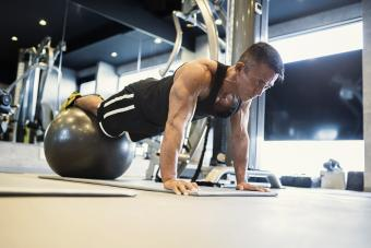 Mature adult man working out at Personal training gym