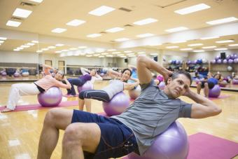 Group on fitness balls in exercise class