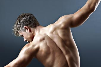 Bare chested man with arms outstretched