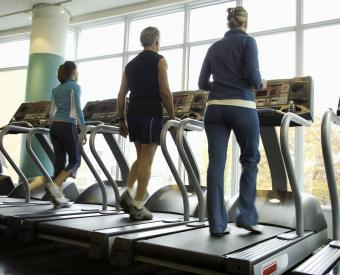 Man and women exercising on treadmill