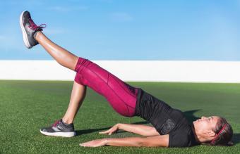 Single leg floor bridge hip lift fitness woman