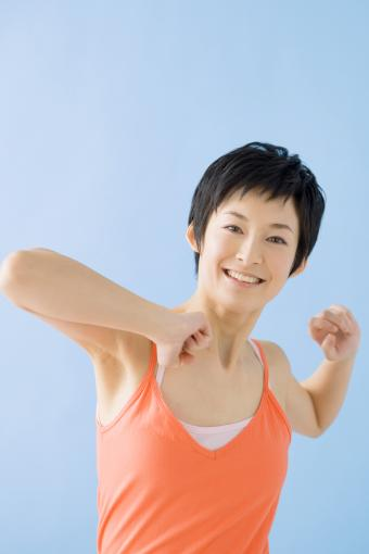 A smiling woman stretching