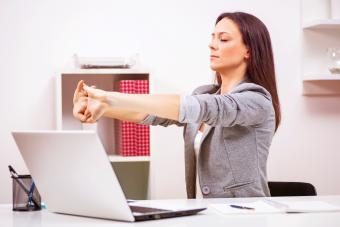 Woman in office streching