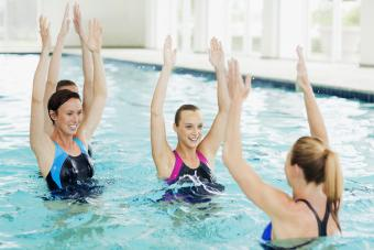 Women taking water aerobics class in swimming pool