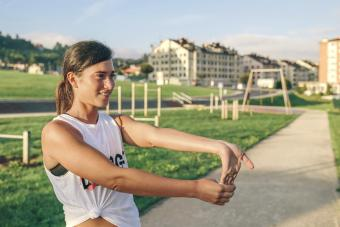 Woman stretching wrist at park