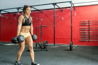 Woman walking with dumbbells