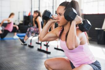 Woman doing squats and holding weights