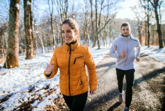 Couple exercising outside on winter morning