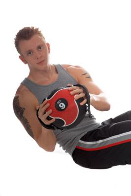 Man working out with medicine ball